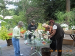 Kathy Irwin Manley, Pat Templin Price, Sandy Torfin Bassett, and Jane Pauley make flower arrangements