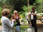 Karen Kasemeier Patton, Sandy Torfin Bassett, and Jane Pauley making flower decorations