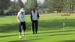 Sharon Yost Dallas and Chris McEachron Hanson on the practice putting green