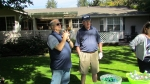 Bill Price and Bill Dallas discussing the finer points of golf in front of the Price residence near the 8th green